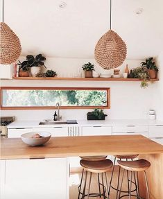 Modern Kitchen Interior bohemian kitchen // minimal kitchen design // bar stools - if you love beachy vibes endless rattan you'll love this Home Decor Kitchen, Rustic Kitchen, New Kitchen, Home Kitchens, Kitchen Dining, Kitchen Walls, Boho Kitchen, Kitchen White, Kitchen Cabinets