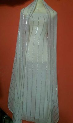 A beautiful Dress of Mukesh work called Chandi Patti.