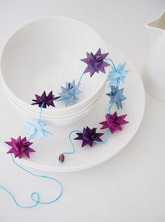 3D folded paper star garland created by Helle Holst of Stjernestunder.