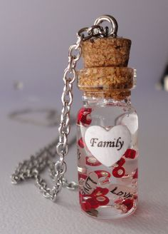 glass bottle necklace, name on rice necklace. $22.50, via Etsy.