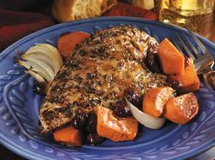 Enjoy this baked chicken and sweet potatoes seasoned with tangy orange juice and cranberries - a flavorful dinner.