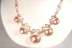 Rose gold wire wrapped necklace handmade by Jessica Luu Jewelry on Etsy  Warm rose gold flat coin Swarovski pearls are set in hand formed 14