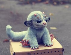earl santaniel, baby dragon named Pearl. made from fimo, fake fur, and wire.  And, obviously, genius.