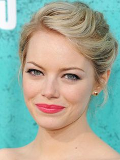 Emma Stone's MTV Movie Awards 2012 makeup was flawless as was her hair.