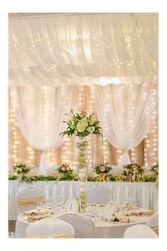 Moments In Time Wedding & Event Rentals ceiling drape and head table backdrop dressed with white voile, gold charmeuse, champagne crystal organza, crystal curtains & fairy lights Image captured by http://lonemanphotography.com/