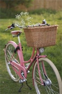 Pretty pink vintage bicycle with basket. Love to ride this on a country lane to find the perfect picnic spot or as a beach cruiser.