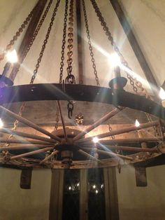 The kitchen light is an old wagon wheel chandelier suspended by chains from the turret center.