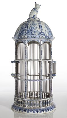 A GROUP OF THREE DUTCH DELFT BLUE AND WHITE BIRDCAGES AND A POLYCHROME BIRDCAGE; 19TH CENTURY
