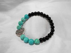 Turquoise and Black Bead Stretch Bracelet with Silver Heart by NfntyArt on Etsy