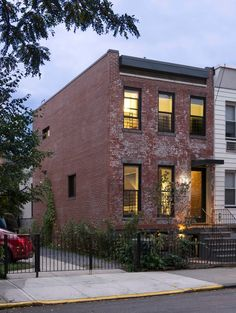 Architecture inspiration: An uncommonly stylish gut renovation of a small Brooklyn row house marries modern graphic elements with rustic original materials. Building Renovation, Brick Architecture, Old Bricks, Brick Building, Interior And Exterior, Townhouse, New Homes, Cottage, House Design