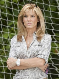Group 1 I chose Sandra Bullock from the Blind Side because she is a strong character in that movie. John