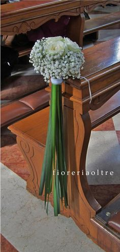 Fioreria Oltre/ Wedding ceremony/ Church wedding flowers/ Pew decoration/ White roses, baby's breath, typha leaves