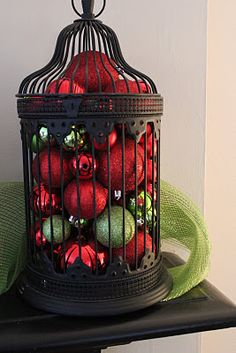 birdcage holding red and green bauble ornaments, me Likey!