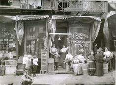 "A group of people standing in front of the Guerrieri Italian grocery store, located at 79 Mulberry Street in the ""Little Italy"" section of Manhattan. This photographic image was taken during America's Gilded Age, ~ {cwlyons} Old Pictures, Old Photos, Little Italy New York, Sailing Day, New York City Pictures, Nyc Pics, Mulberry Street, Old Portraits, Vintage Photographs"