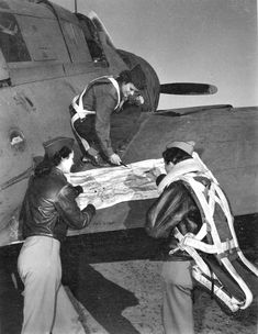 Three WASPs on right wing of A-25 checking the flight plan before a tow mission. The Curtiss A-25 Shrike was a single-engine, two-seat dive bomber deemed to be too vulnerable to enemy fighters, and were therefore redesignated for use as trainers or light personnel and cargo transports. WASPs a