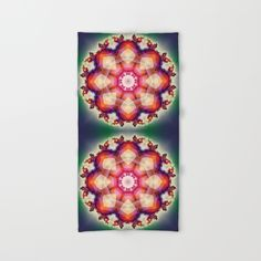 Decorative mandala with translucent colors. The colors are pink, red, orange, green and blue. (patterns...