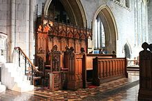 The stalls of St. Canice's Cathedral, Kilkenny, Ireland, showing the bishop's throne and precentor's stall.