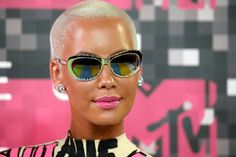 Amber Rose's Onesie Is VERY Graphic: http://www.marieclaire.com/fashion/news/g3137/best-dressed-at-2015-vmas/?slide=13 … #VMAs