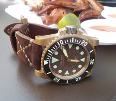 Helson shark diver black on bronze. Massive oversized case, huge luminous markers, raised bezel with deep grasping grooves, classic design, and thankfully not a Rolex homage. =)