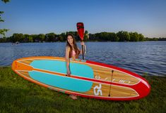 Shoreline Stand Up Paddle Board (Sunburst Orange)The Shoreline Series SUP is a great all-around family friendly paddleboard. This SUP is best for paddlers of all ranges from beginners to advanced. The red to orange ambre color transitions across Stand Up, Board Stand, Paddle Boarding, Light In The Dark, Surfboard, Orange, Outdoor Decor, Lighter, Color