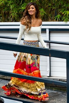 Channeling a hippie vibe, Nicole Scherzinger glowed in a colorfully printed maxiskirt and beige cropped top. [Photo by Ben Pruchnie/GC Images]