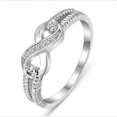 Elegant Rhodium Plated Sterling Silver Womens Infinity Ring ($80) ❤ liked on Polyvore featuring jewelry, rings, sterling silver infinity jewelry, sterling silver rings, sterling silver jewellery, infinity jewelry and sterling silver jewelry