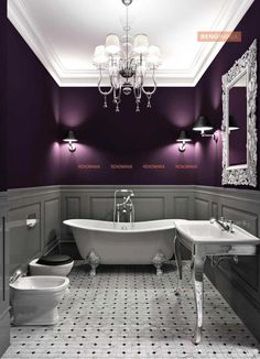 Sheer Victorian pleasure shines through the stand alone roll-top Bath, the silver-legged sleek basin, the sinuous Chandelier with 6 shades and wall mounted lamps that cast a play of shade on the half royal-aubergine walls. The intricately fashioned mirror borders in the right setting make this bath truly spectacular.