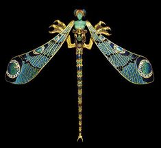 Dragonfly woman corsage ornament (1897–1898) by René Lalique. Gold, enamel, chrysoprase, moonstones, and diamonds.