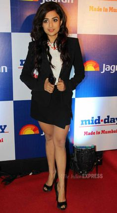 Singer turned actress Monali Thakur looks petite in formal blazer and skirt at mid-day relaunch party.
