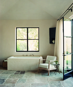 Dream The End - Jean-Michel Frank. Tile floor.white plaster walls.steel and glass door.black window.bathroom