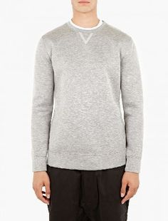 Helmut Lang Grey Tape-Detail Sweatshirt The Helmut Lang Tape-Detail Sweatshirt for AW16, seen here in grey. - - - Crafted in the USA from a unique Italian sponge-backed modal for a structured, boxy fit, this sweatshirt from Helmut Lang is f http://www.MightGet.com/january-2017-13/helmut-lang-grey-tape-detail-sweatshirt.asp