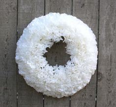This shabby chic white coffee filter wreath is made of over 75 individually hand dyed coffee filters. The wreath has a very romantic feminine