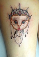 A tattoo of a barn owl made to look like a mask, this is just creative and cool!