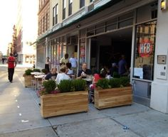roll up doors. Use planter boxes inside to give sectional seating.