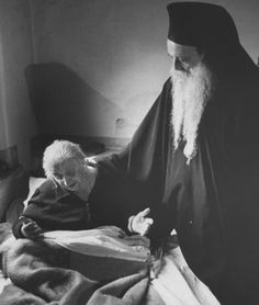 Eastern Orthodox Church Patriarch Athenagoras I, Archbishop of Constantinople (Istanbul), visits a sick member of the church, 1967