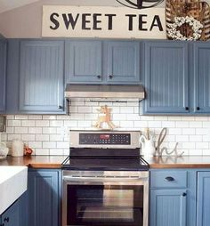 Cornflower blue cabinets, subway tile, farmhouse sink, amd butcher block.. great diy kitchen remodel inspiration! Modernouse Kitchen Cabinet Ideas (5)
