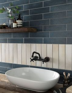 Add a splash of colour to your walls with the elegant, streamlined features of Anya™. With the Dulux colour of the year for 2017 named as Denim Drift, the introduction of Anya brings cool blue-grey tones into the Topps Tiles colour palette, making it the Grey Bathroom Tiles, White Bathroom, Bathroom Wall, Wall Tiles, Bathroom Ideas, Grey Tiles, Washroom, Kitchen Tiles, Blue Grey Bathrooms