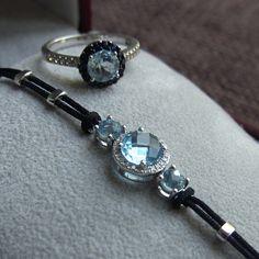 14k white gold bracelet with topaz and diamonds, 14k white gold ring with topaz, sapphires and diamonds