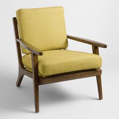Textured muted lime green cushions with a subtle two-tone weave pop against a sleek wood frame finished in dark espresso. This handsome mid-century-inspired chair boasts a vertical slatted back and a deep seat for comfortable lounging.