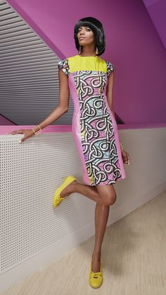 A lovely A-line dress gets a playful update with bright uni-colour panels and an off-centre zipper at the collar.