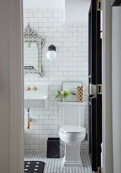 A Home For Sale Runs Amok {part II} bathrooms and more | perfect bathroom for a prewar apartment | white subway tile with black accents and a wonderful Venetian mirror