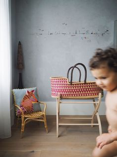 A modern baby girl nursery with our Nima crib, complemented with the first rattan sample we've got in - The Kind Label