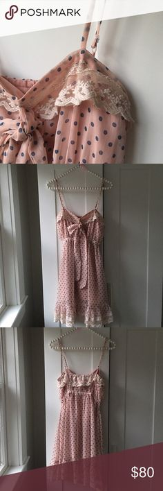 Garcia Lace Polkadot Dress Exquisite! This blush pink & blue Polkadot dress is embellished with an ivory lace at the top and the hem that creates a ruffle effect. Adjustable Cami straps. Garcia Dresses Mini