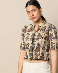 Featuring a vibrant kalamkari print and front zip closure, this princess seam cotton blouse brings imaginative sophistication to the wardrobe. Blouse Back Neck Designs, Fancy Blouse Designs, Kalamkari Blouse Designs, Cotton Saree Blouse Designs, Kalamkari Blouses, Kalamkari Saree, Stylish Blouse Design, Designer Blouse Patterns, Beige Blouses