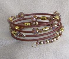 Easy Breezy by Nancy Vaughan. Love the colors. Rubber tubing memory wire bracelet