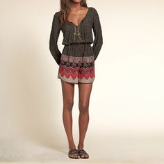 Girls Patterned Drapey Romper | Lightweight and drapey with all-over pattern, cinched waist, split v neckline with tassel detailing and cinched arm openings | HollisterCo.com