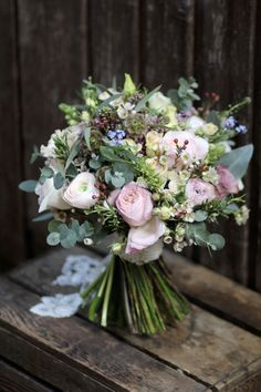 Natural and rustic bridal bouquet, containing spring flowers and David Austin Garden style Roses