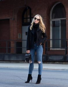 Helena Glazer keeps it striking and simple here, in a double breasted navy coat, matching cable knit turtleneck sweater, and distressed denim jeans. Wearing heeled boots with this look adds that perfect touch of glamour, while a mini handbag combines the smart and the fabulous. Coat: Slate & Stone ℅, Turtleneck: Banana Republic, Denim: Topshop, Boots: Louboutin, Sunglasses: Fendi, Handbag: Mackage, Belt: Saint Laurent.