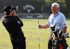 Rory with his dad on the range