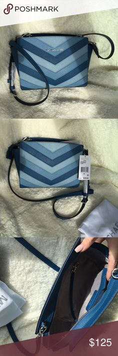 Michael Kors MK Selma Blue Chevron Crossbody BRAND NEW WITH TAGS 💙  Super cute blue chevron Selma MK bag! Features adjustable strap and pocket inside.  Includes MK dust bag. Offers welcome! MICHAEL Michael Kors Bags Crossbody Bags
